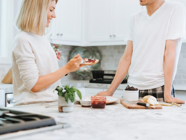 woman and man eating in kitchen